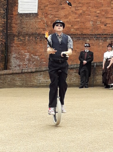 Unicycle and fire juggling entertainment by circus wunderbar on steam punk event in Nottingham